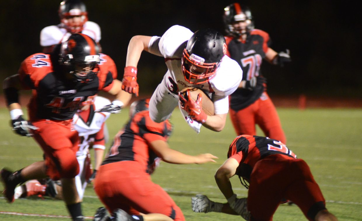 Aspen running back Ryan Fitzgerald gets airborne in the fourth quarter of the Skiers win against Steamboat on Friday night.