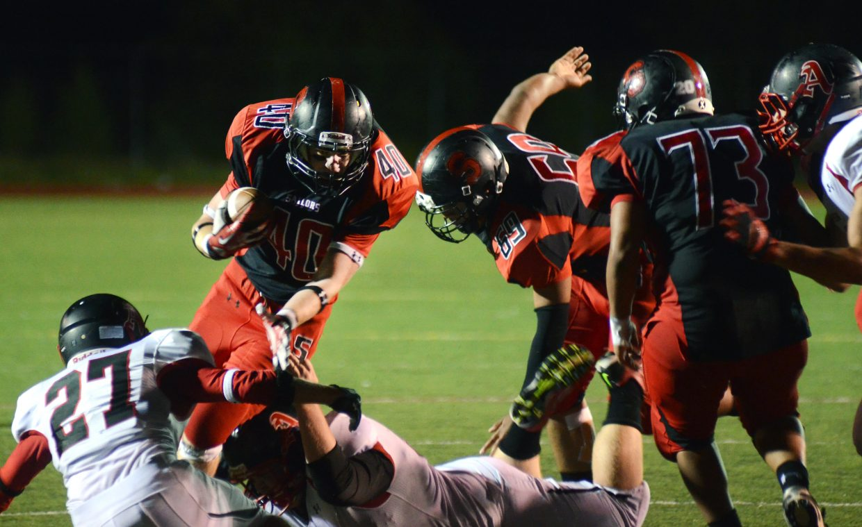 Steamboat running back Scott Lang fights for the goal line in the Sailors' 23-14 loss to Aspen on Friday night.
