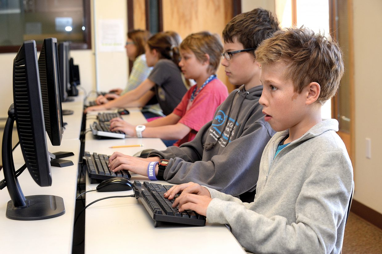A Steamboat Springs Middle School student works on a computer in 2014. The district is asking for about $160,000 less in technology funding from the Education Fund this year.