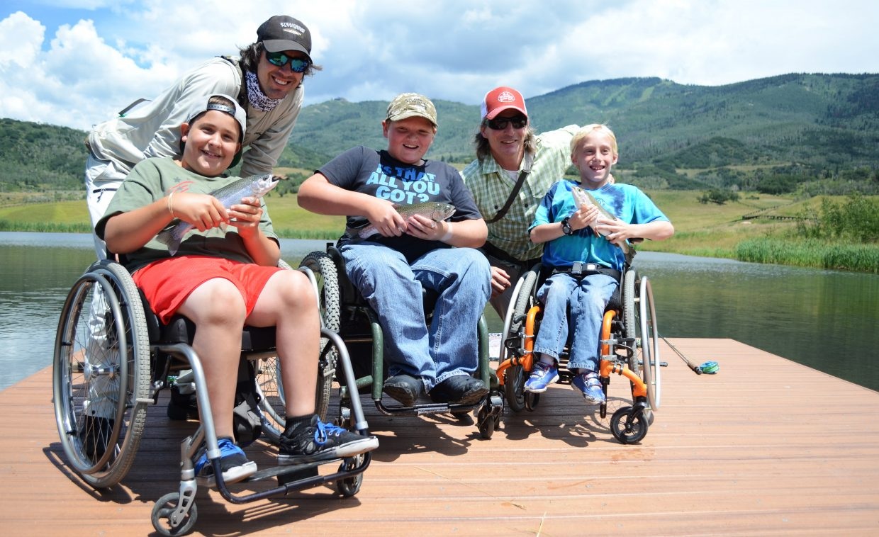 STARS clients Paul Stoiber, Kyle Taulman and Casey Myers show off their trio of catches Friday at Alpine Mountain Ranch with Steamboat Flyfisher owner Johnny Spillane and guide Todd Krentz.