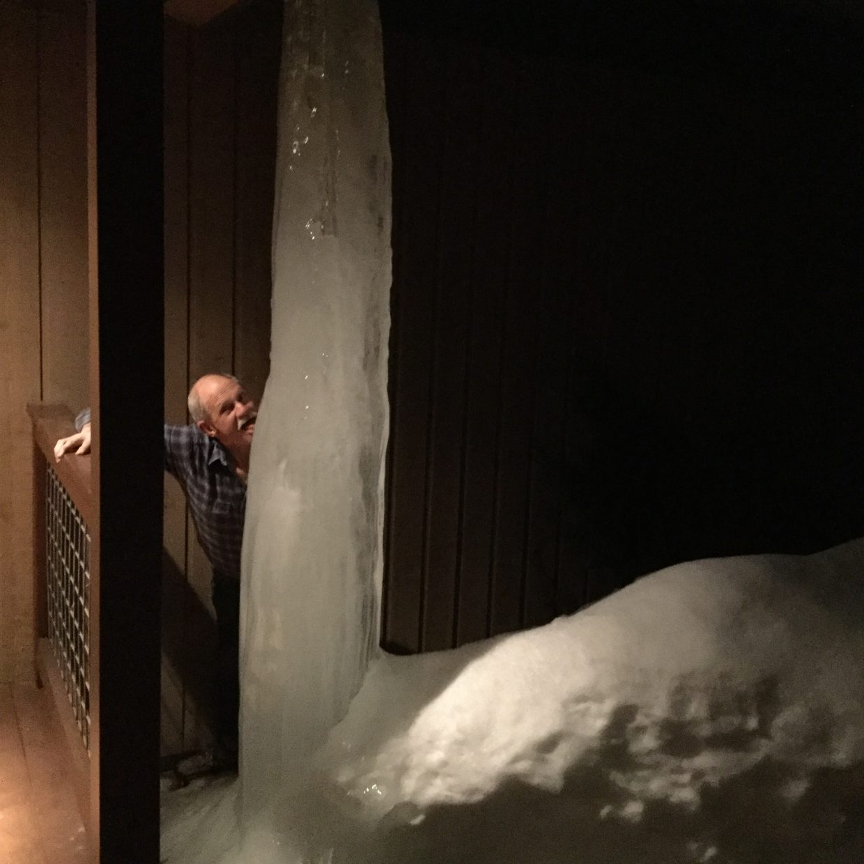 """Daredevil Doug (Smith) tests the ice column with his tongue. And he is still there."" Submitted by Sally Wackowski."