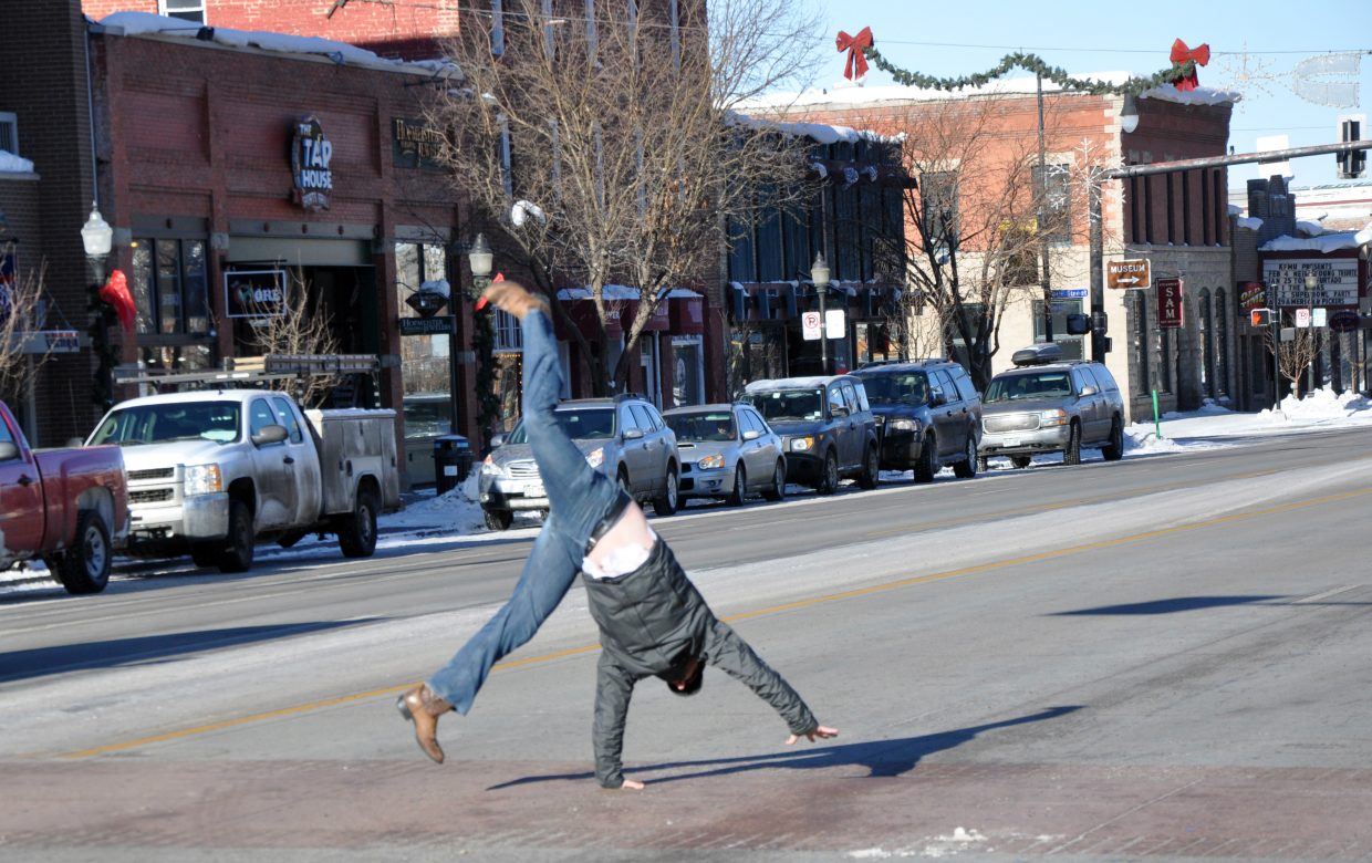 Jon Sanders does a cartwheel on Lincoln Avenue. Sanders is the new board president for Mainstreet Steamboat Springs.