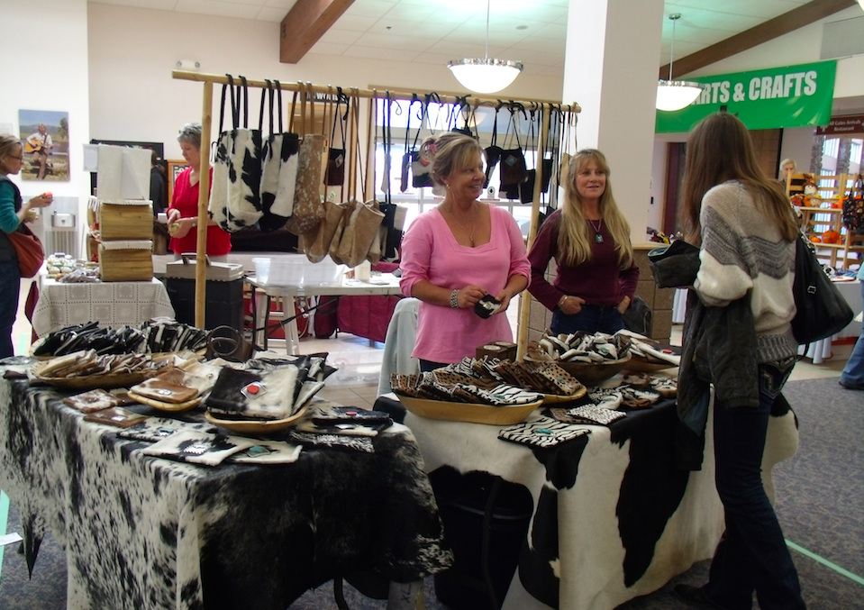 Vendors help a customer select a gift at last year's arts and crafts fair held at the Yampa Valley Regional Airport. This year's fair will be held form 10 a.m. to 3 p.m. Saturday.