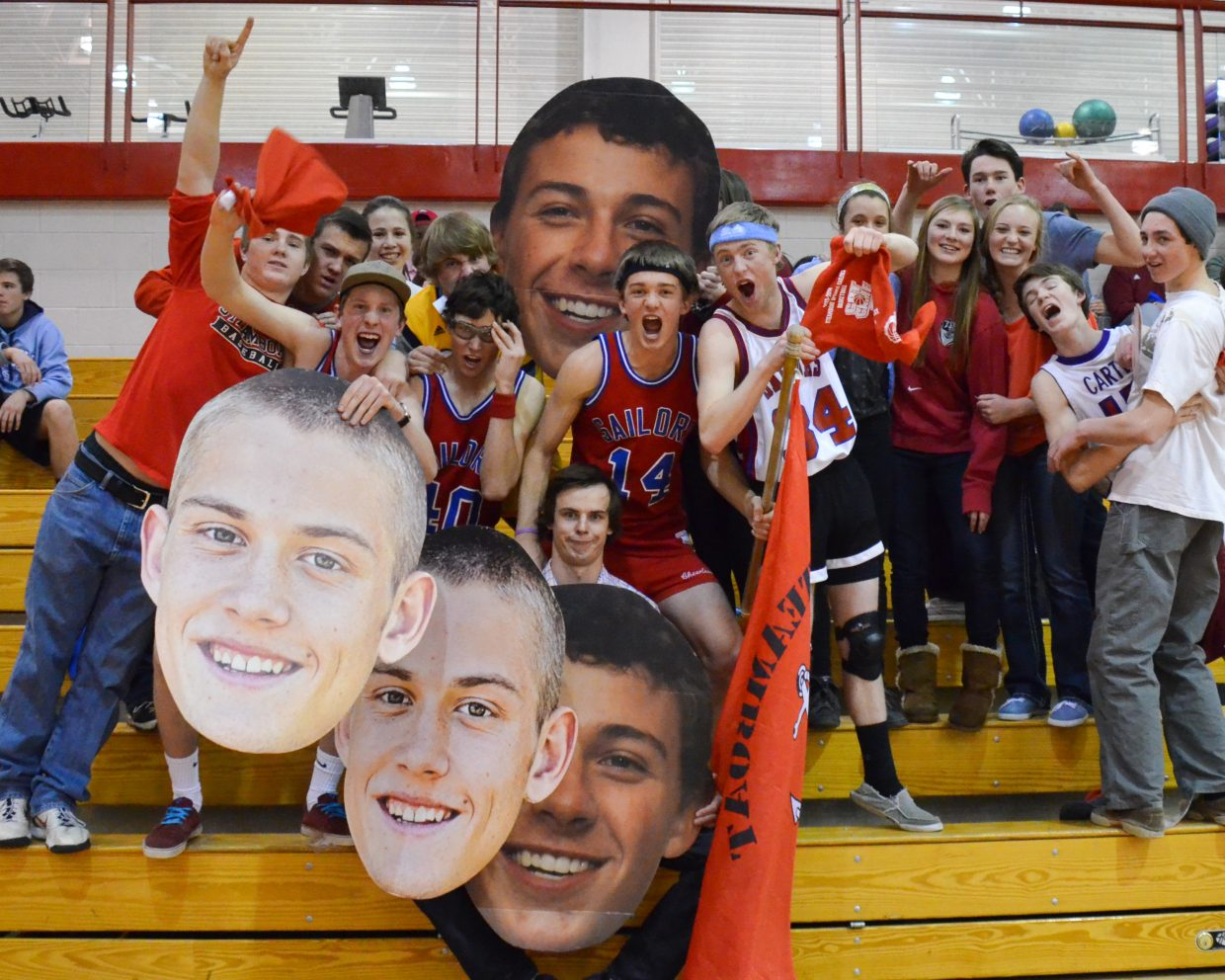 Steamboat fans celebrate senior night with big heads of Sailors players Carter Kounovsky and Zach Dunklin during the game against Summit County on Tuesday night.