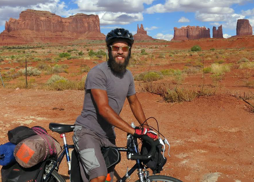Steamboat Springs resident Sergio Ryan stops for a picture near Monument Valley, Utah, as part of a 2,200-mile solo bike ride this fall.