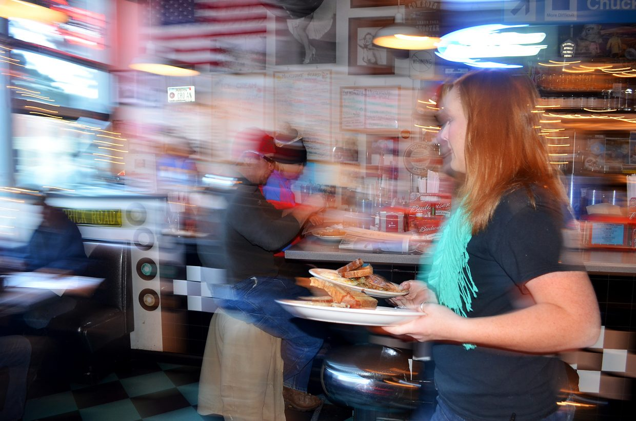 Shealynne Yeager serves breakfast to hungry patrons early one morning.