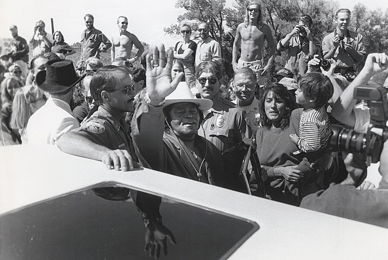 James Brown waves to the crowd in Steamboat Springs during a ceremony naming the James Brown Soul Center of the Universe Bridge in his honor in September 1993. This photograph of Brown was taken by John F. Russell.