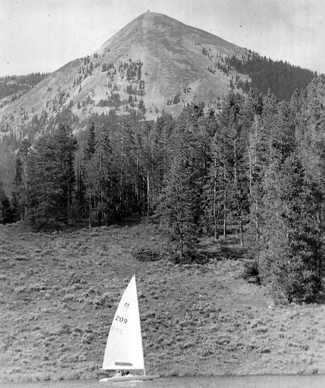 A sailboat makes its way across Steamboat Lake. This photograph was taken by former Steamboat Today photographer Tyler Arroyo in the early 1990s.
