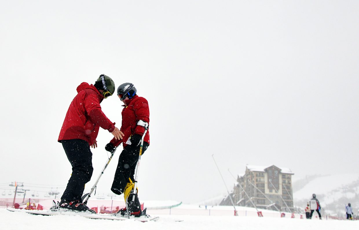 Chris Babcock, left, helps Montana Dalman learn to ski at Steamboat Ski Area as part of the Sunshine Kids program.This photograph was taken by Scott Franz and appeared in the Feb. 27, 2013, edition of the Steamboat Today.