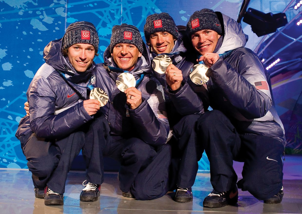The U.S. Nordic Combined Ski Team showed off its silver medals during the 2010 Winter Olympics. The team, which included, from left, Brett Camerota, Todd Lodwick, Johnny Spillane and Billy Demong, raced to second place in the team event earlier in the day. The photograph was taken by John F. Russell and appeared in the Feb. 24, 2010, Steamboat Today.