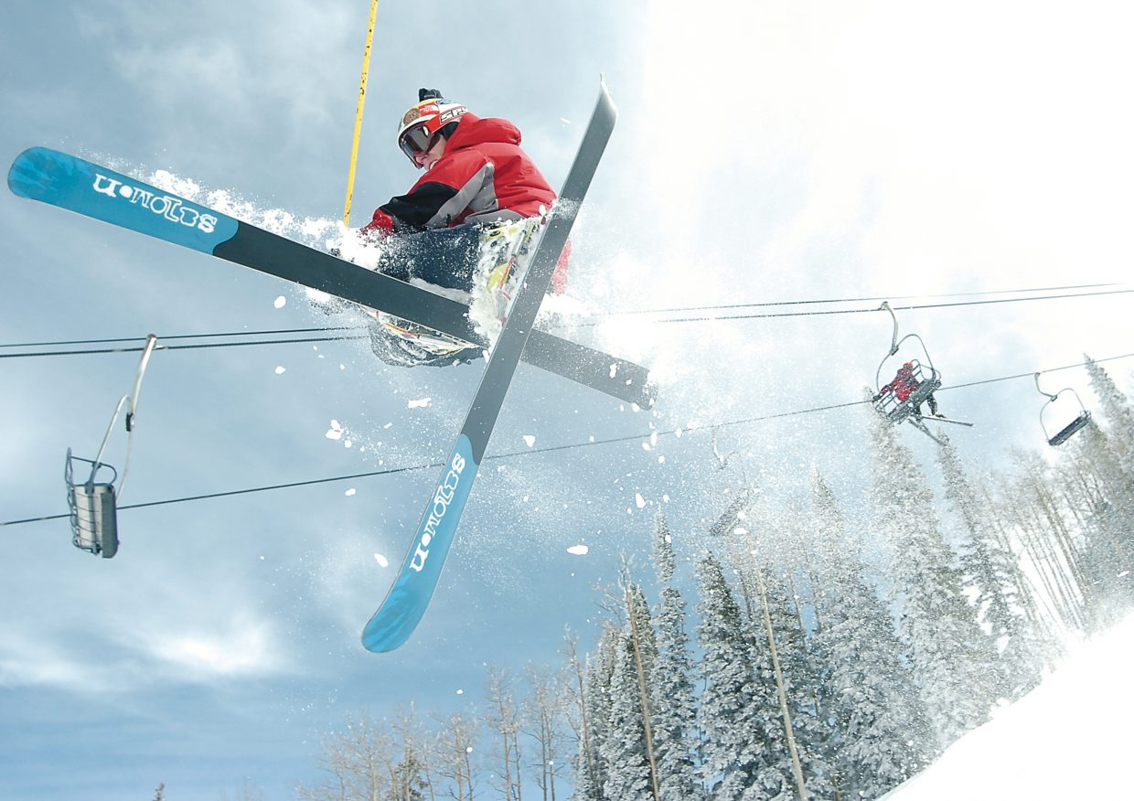 Steamboat Springs Telemark skier Kevin Olsen gets a taste of Steamboat Springs' mountain air after hitting a jump near the Burgess Creek lift line. The photograph was taken by John F. Russell and appeared in the April 1, 2006, edition of the Steamboat Today.