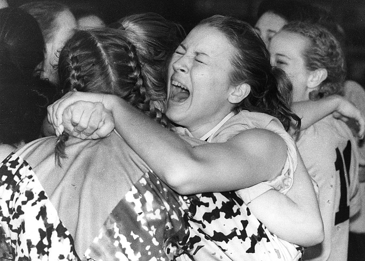 Steamboat soccer player Jennifer Fritz hugs Shannon Hurley after Steamboat beat Palisade to win the state title. This photograph was taken by John F. Russell and appeared in the May 18, 1998 edition of the Steamboat Today.