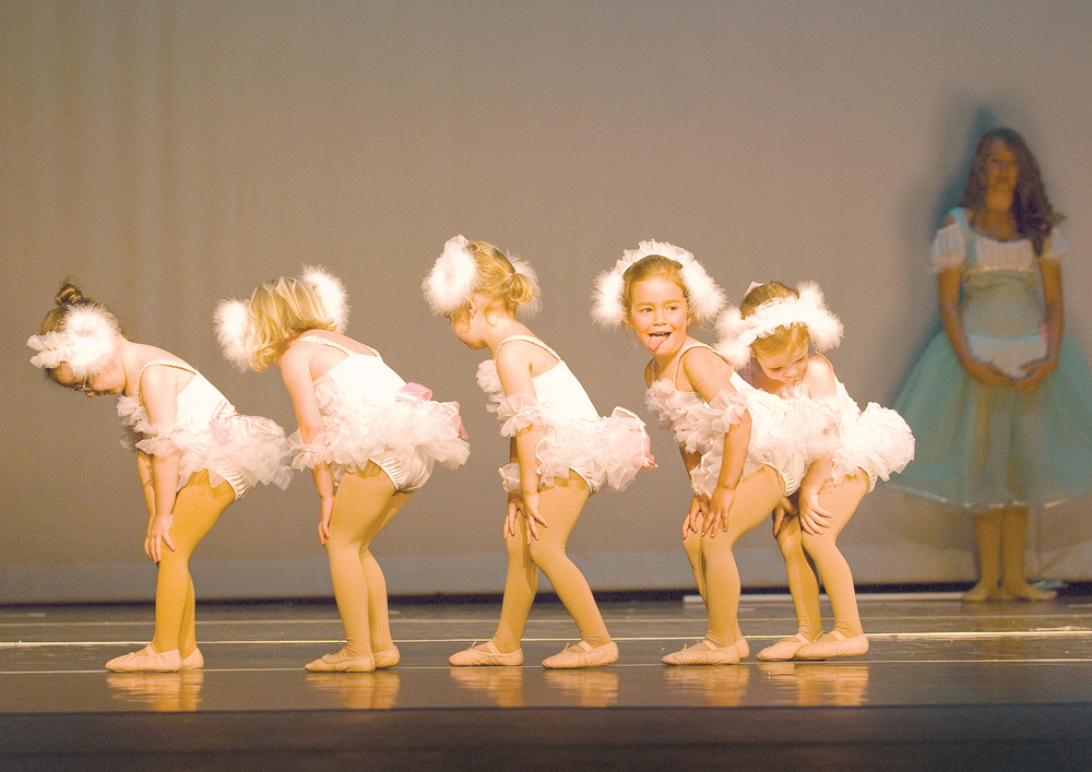 """Dancers, from left, Andie Koly, Allie Van Ness, Sophie Flam, Kaitlyn Greenwood and Kelsey Norland play the part of the little lost lambs during a dance number, which also featured veteran dancer Courtnee Weiss (background), called """"Shepherd Girl & Little Lost Lambs."""" This photograph was taken by John F. Russell and appeared in the May 11, 2009, edition of the Steamboat Today."""