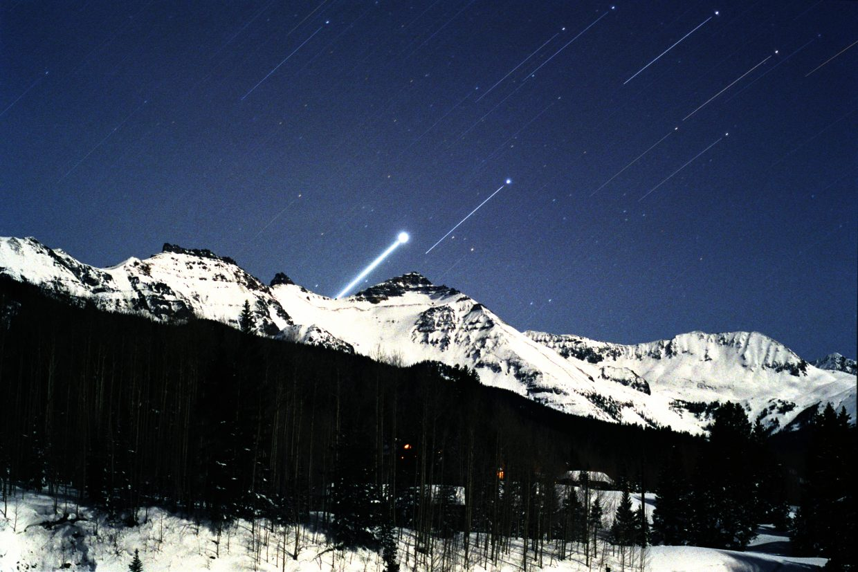 "Is the Dog Star, Sirius, responsible for the oppressively hot days of late July? The ancient Greeks thought so, hence the expression, ""the dog days of summer."" In this time exposure, taken in January 2005, the Dog Star is seen rising over the snowy mountains near Telluride. The Dog Star is in the daytime sky alongside the sun between July 3 and Aug. 11 and cannot be seen."
