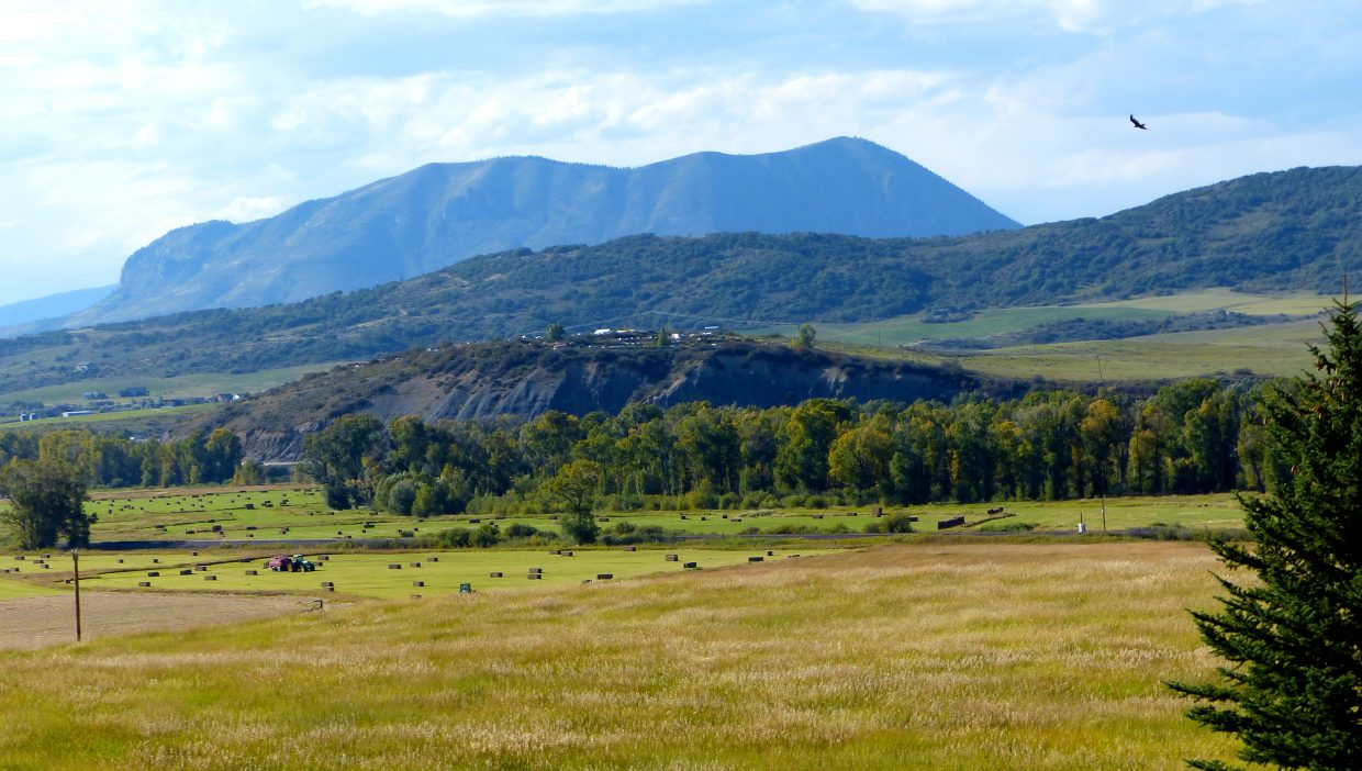 Sleeping Giant sits pristinely with hay harvesting in the foreground. Photo courtesy of Steve Dunklin.