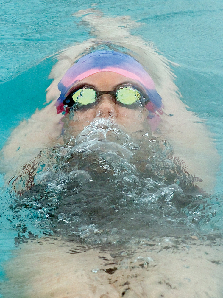 Steamboat swimmer Molly Dierdorff works on her backstroke while practicing with Team Lightning — the Steamboat Springs Swim Team — at the Old Town Hot Springs lap pool. The photograph was taken by John F. Russell and appeared in the April 1, 2009, edition of the Steamboat Today.