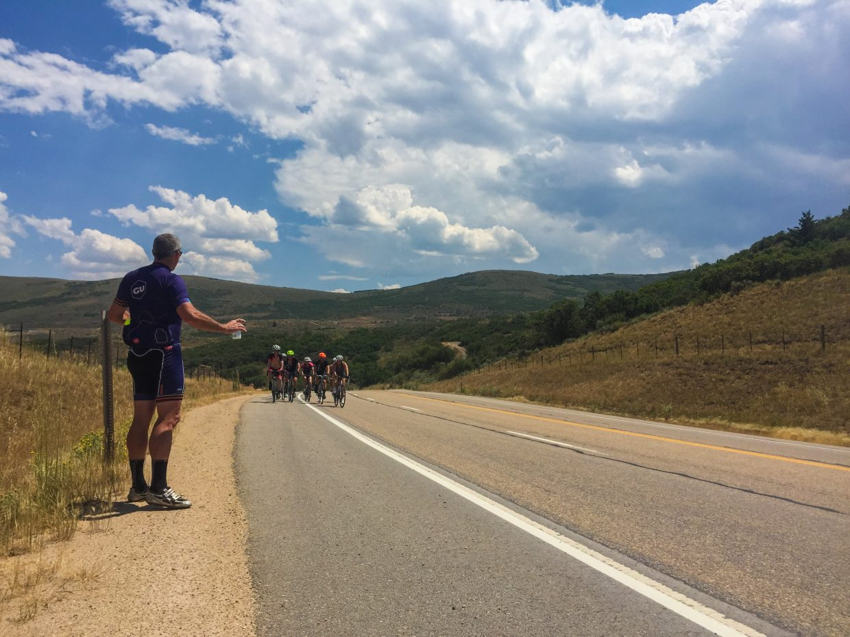 Bicyclists in Steamboat's 10th anniversary ride to the tradeshow approach an aid station en route to Salt Lake City. SmartWool/courtesy