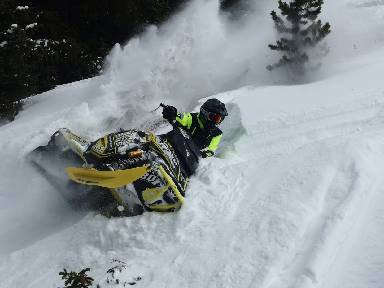 Pro snowmobiler Brett Rasmussen rips up Rabbit Ears Pass during a recent trip to teach diehard backcountry skier, Edge, vice president of Backcountry Access, and Steamboat Living/Explore magazines editor Eugene Buchanan some snowmobile riding tips.