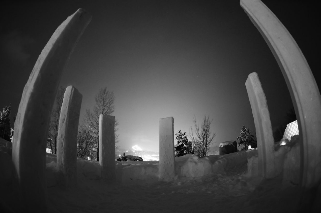 The SKY Club's icy version of Stonehenge, called Snowhenge, consists of six towering monoliths of snow and overlooks downtown Steamboat Springs and Howelsen Hill. From Snowhenge, visitors can peer through a telescope to see the wonders of the universe beyond Earth. Photo courtesy of Jimmy Westlake.