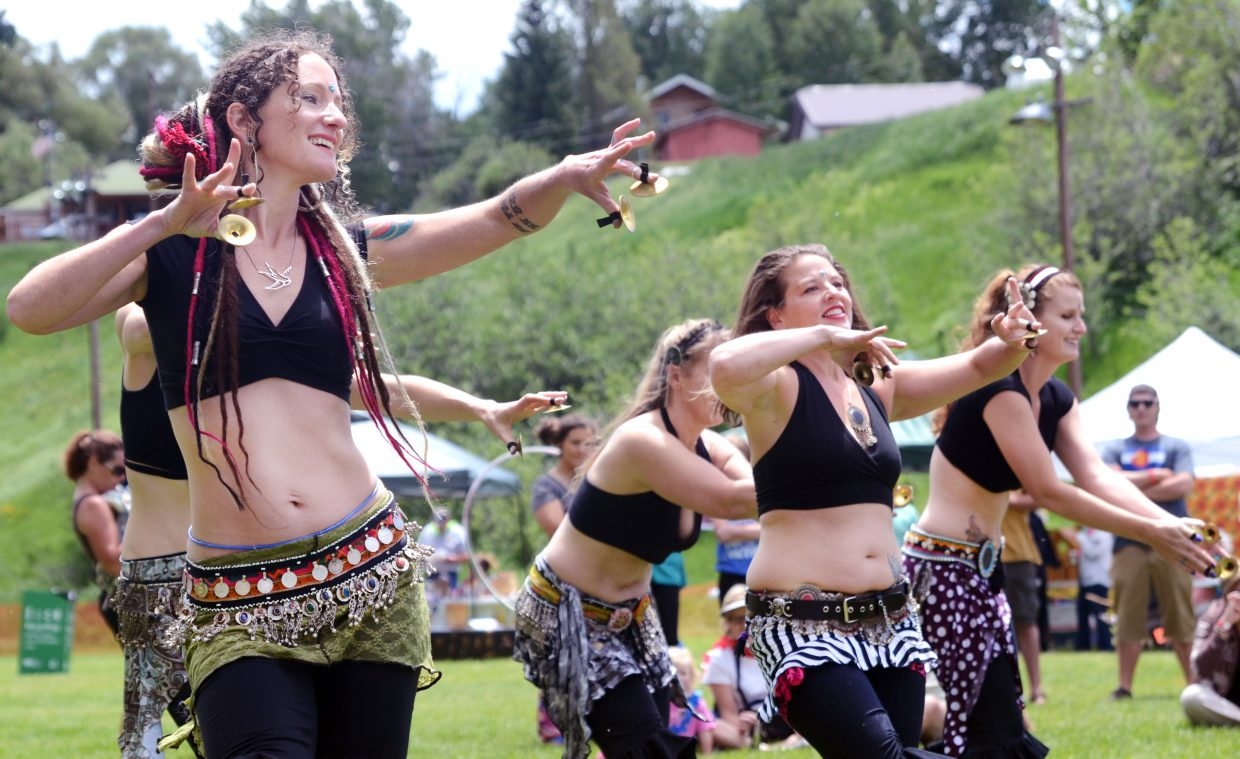 Dancers from Jasmir Tribal Fusion Bellydance put on a show at Decker Park during Taste of South Routt on Saturday afternoon in Oak Creek.