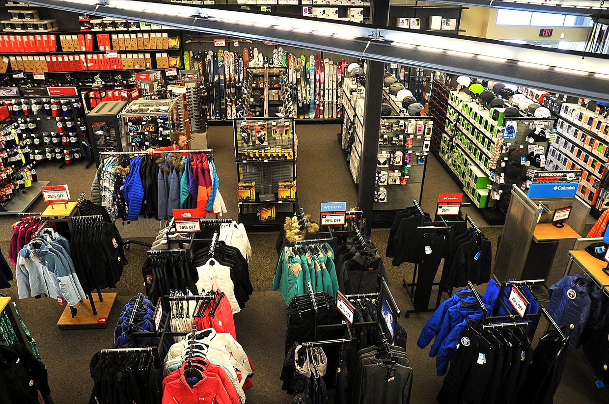 Sports Authority store manager Dan Harvey wheels out apparel on the sales floor on Wednesday. The Steamboat Springs location is not on the list of stores Sports Authority plans to close after filing for bankruptcy protection.