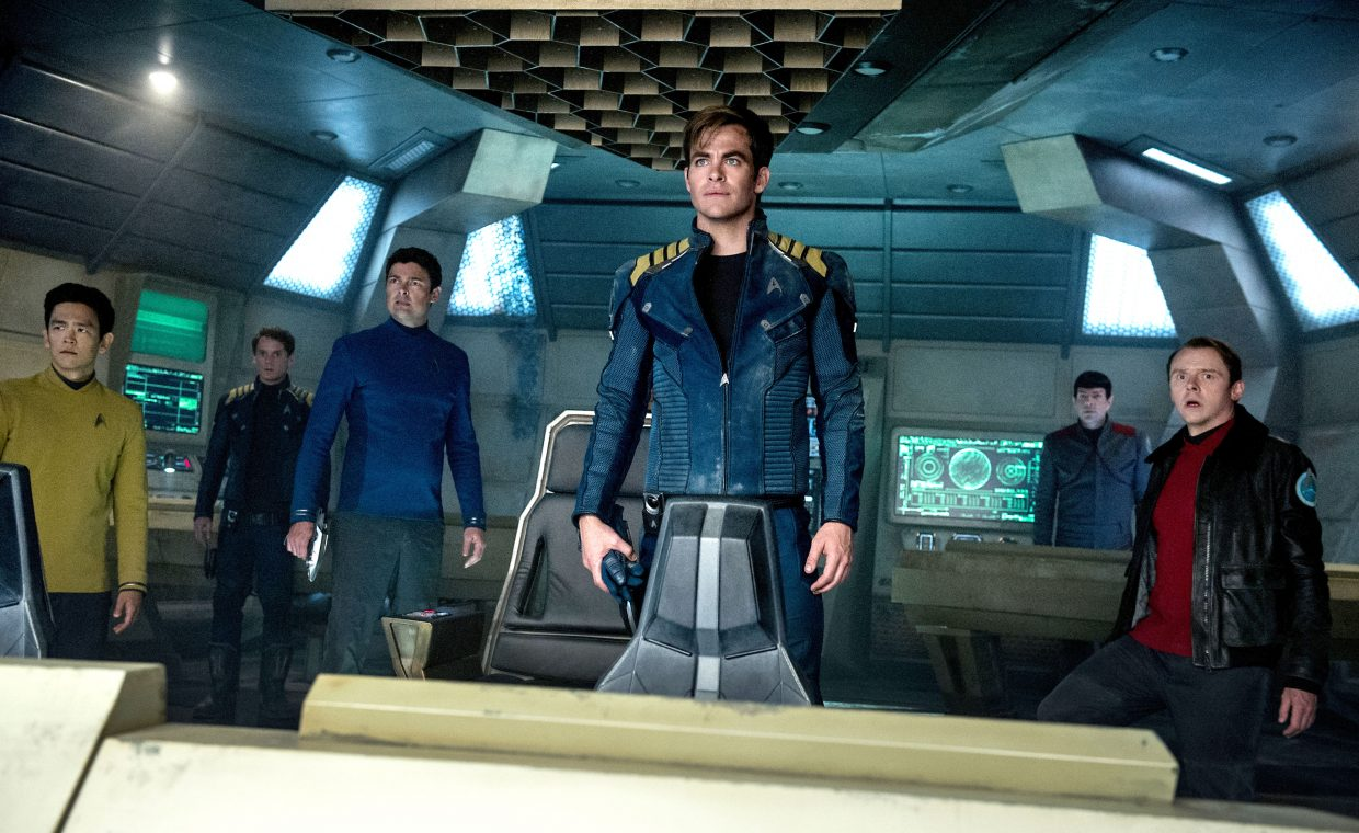 "Members of the USS Enterprise Hikaru Sulu (John Cho), Pavel Chekov (Anton Yelchin), Leonard McCoy (Karl Urban), James Kirk (Chris Pine), Spock (Zachary Quinto) and Montgomery Scott (Simon Pegg) are in a tight spot in ""Star Trek Beyond."" The movie follows the 23rd century adventures of the crew amid their five-year mission."