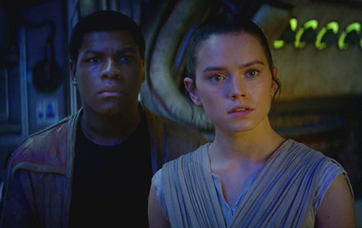 "Finn and Rey (John Boyega, Daisy Ridley) learn what kinds of stakes are in store for them in ""Star Wars: The Force Awakens."" The movie is the seventh in the series set in a galaxy far, far away."