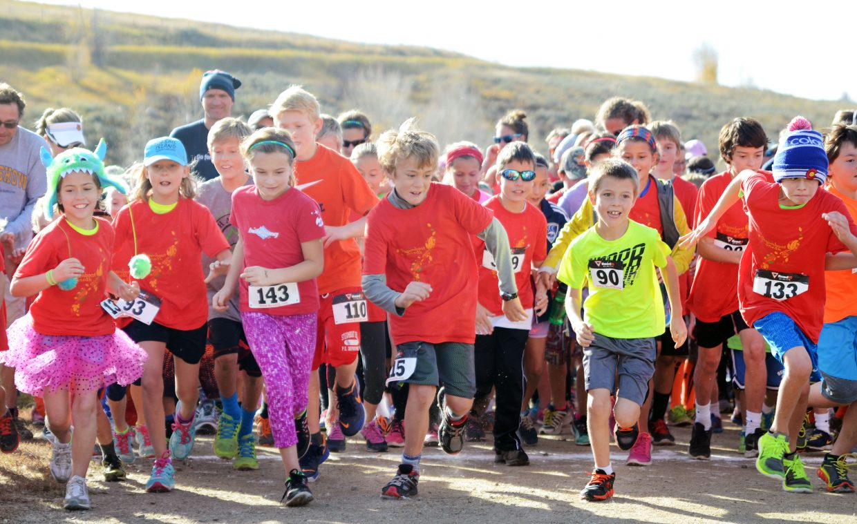 Steamboat Sneak 5K runners take off at the starting gun Saturday, starting at the Steamboat Springs Middle School track. The annual race serves as a big partnership fundraiser with the Steamboat Springs Challenge Fund, which brings extra education programs to local classrooms, such as book fairs and science exhibits.