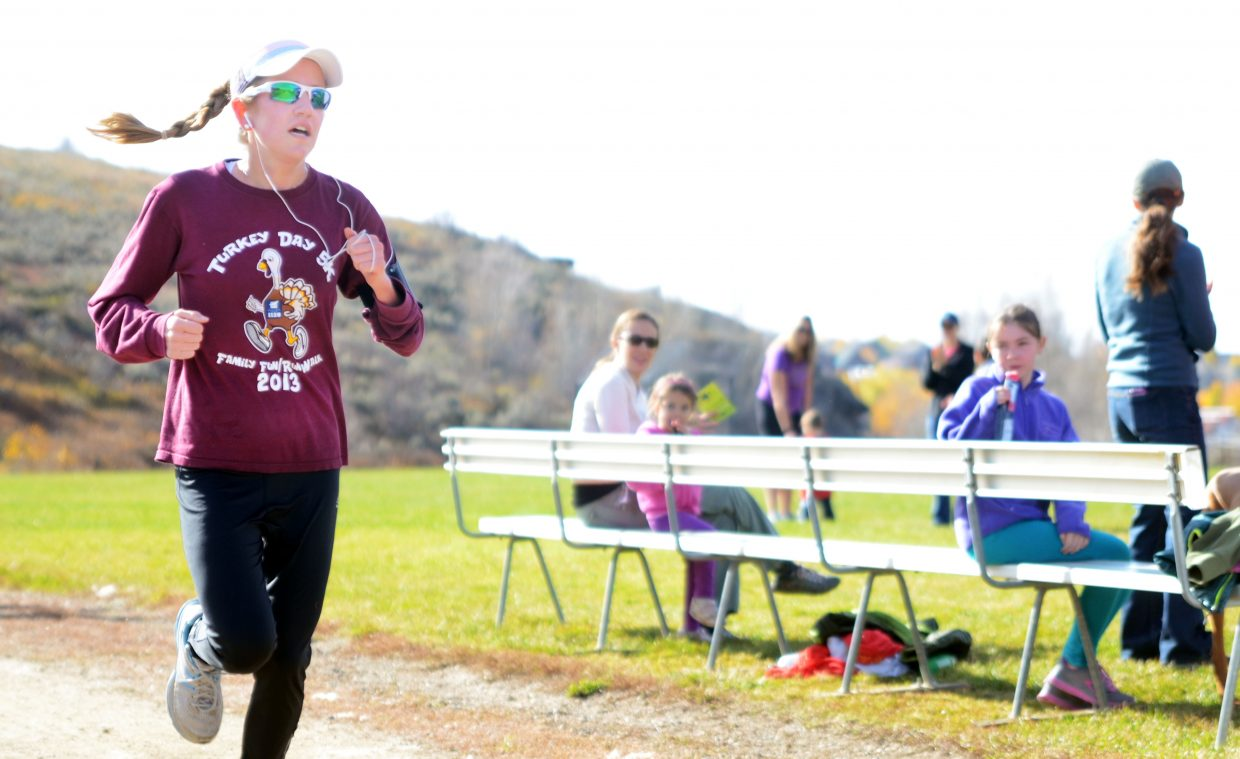 Steamboat Sneak 5K winner Holly Schaefer crosses in just less than 20 minutes Saturday. Schaefer is a high school student from Denver.