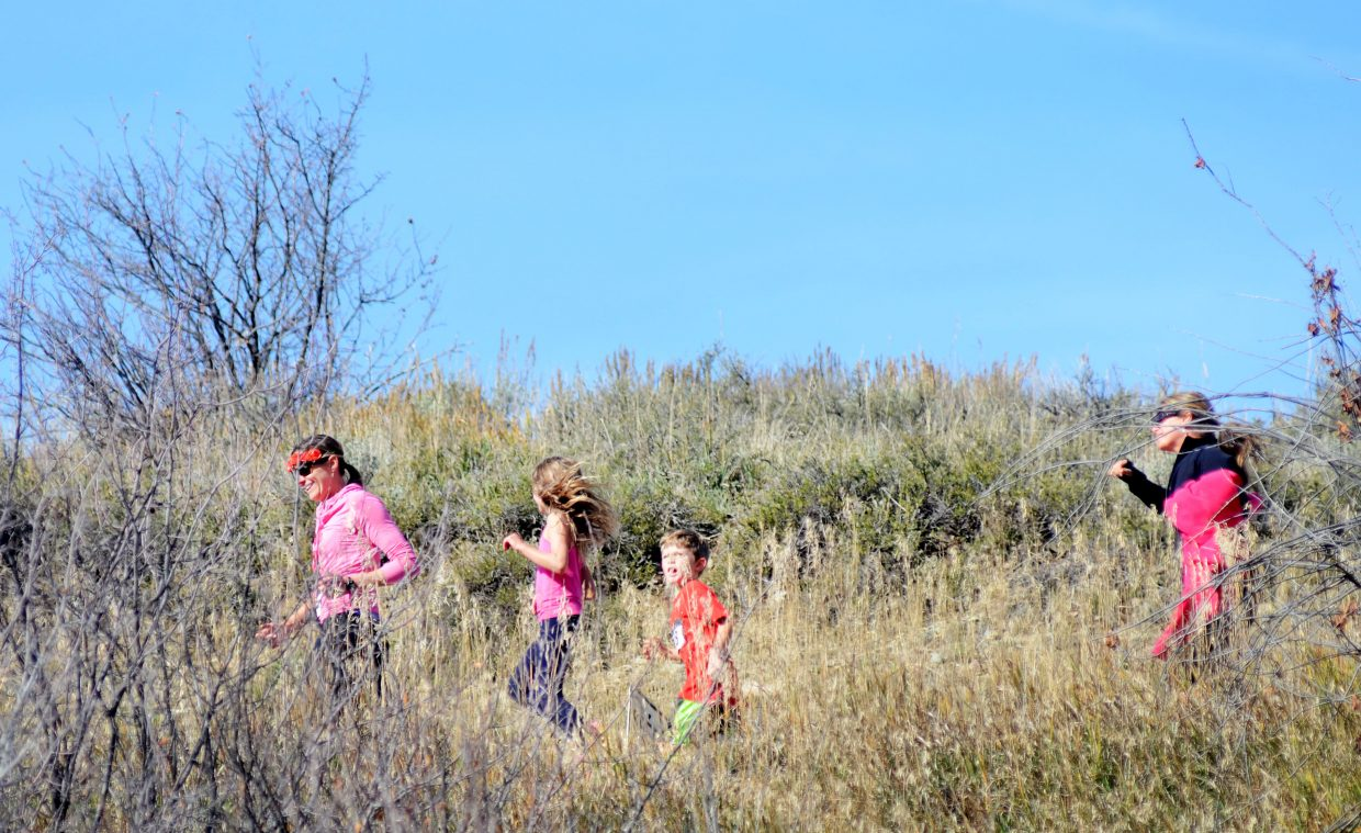 Runners in the Steamboat Sneak 5K head along Butcherknife Canyon Trail on Saturday. The annual race raises money for Strawberry Park and Soda Creek elementary schools.