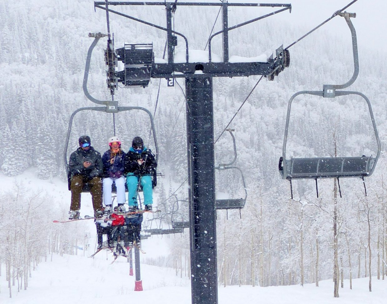 My three teenagers all looking at their phones on the chairlift, and taking Snapchat pictures. Submitted by: Shannon Lukens