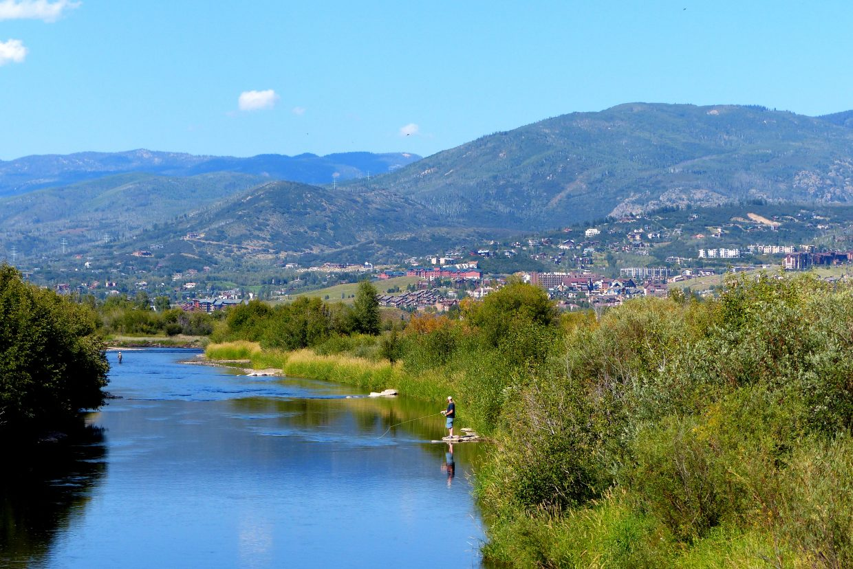 A couple of fishermen in the Yampa River with Steamboat in the background. Submitted by Shannon Lukens.