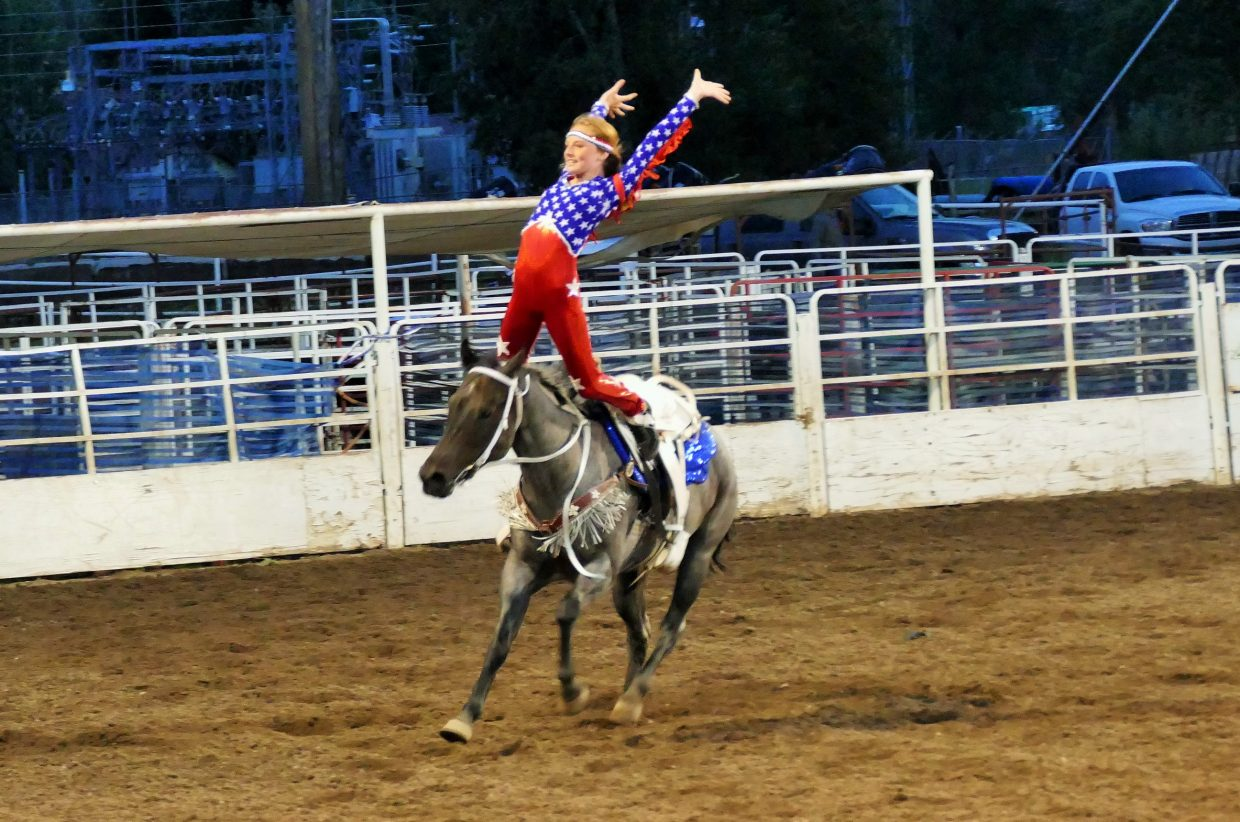 I zipped over to the rodeo for just a few minutes tonight… the Steamboat Springs Pro Rodeo Series. Here is a picture of a trick rider. Shannon Lukens.