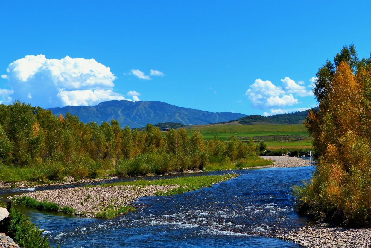 A picture perfect day in Steamboat. The Yampa River with the mountain in the background. You can just see the leaves starting to turn, in the tree on the right. Taken from the Steamboat Golf Club at River Bend. Submitted by Shannon Lukens.
