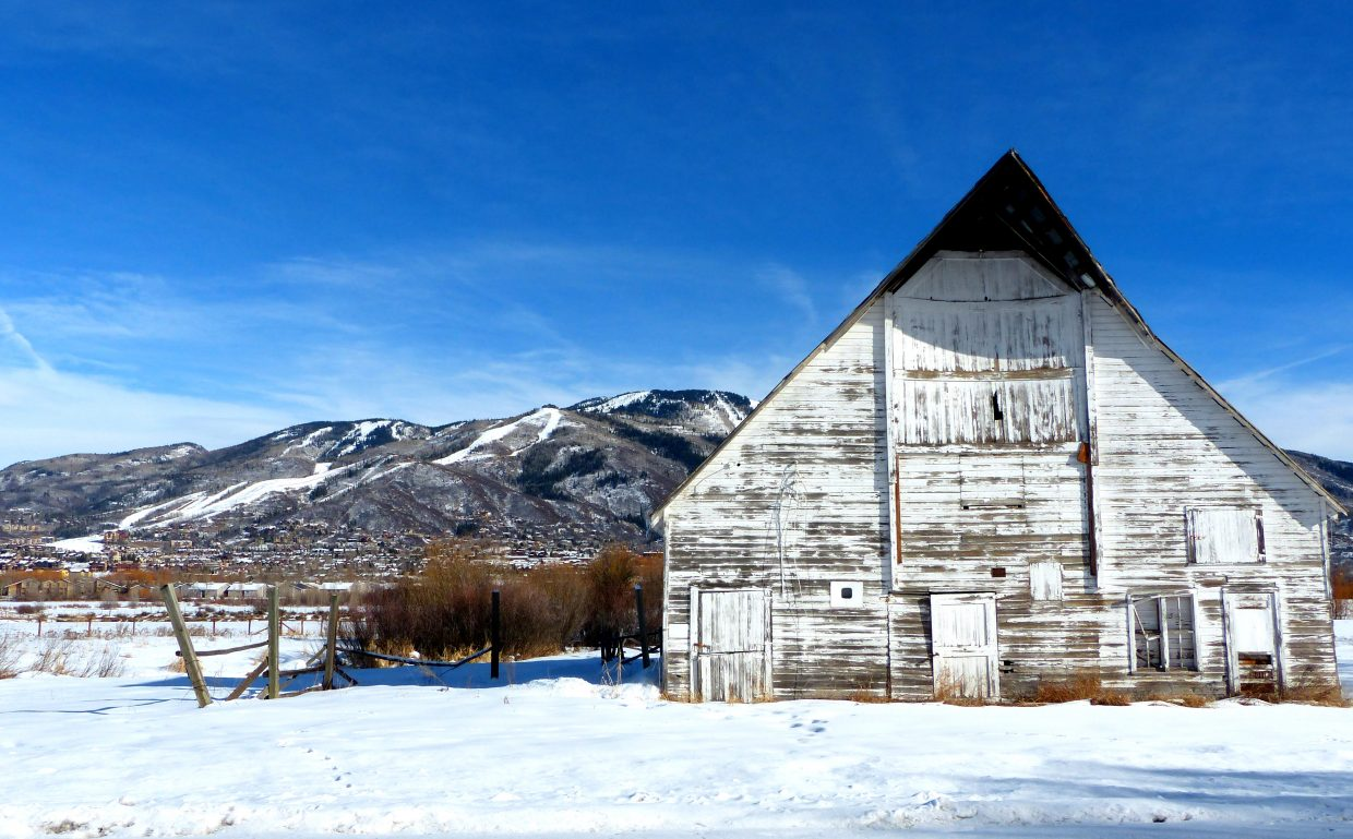"""An old barn on River Road, with the Steamboat Ski area in the background."" Submitted by Shannon Lukens."