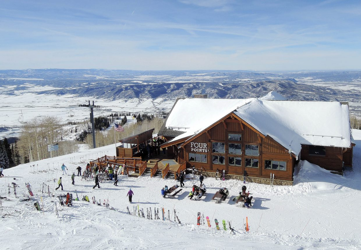Skis and snowboards are stacked outside the new Four Points Lodge on Wednesday at Steamboat Ski Area.