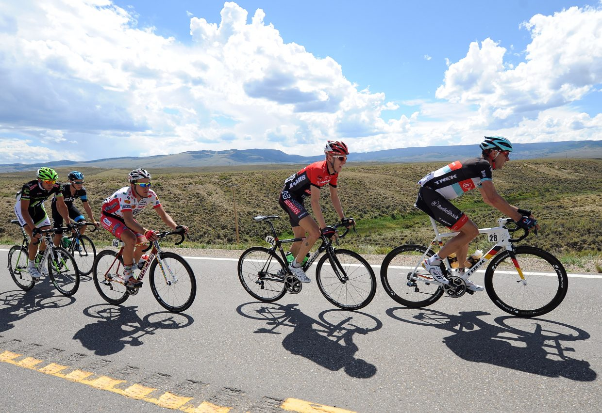 A breakaway group tries to keep its distance from the peloton during the 2013 USA Pro Challenge.