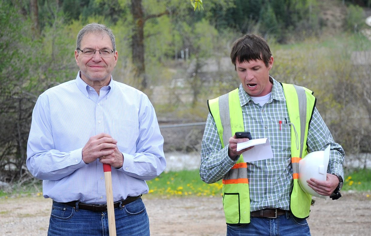 City Manager Gary Suiter, left, listens to City Engineer Danny Paul during a groundbreaking ceremony on Yampa Street.