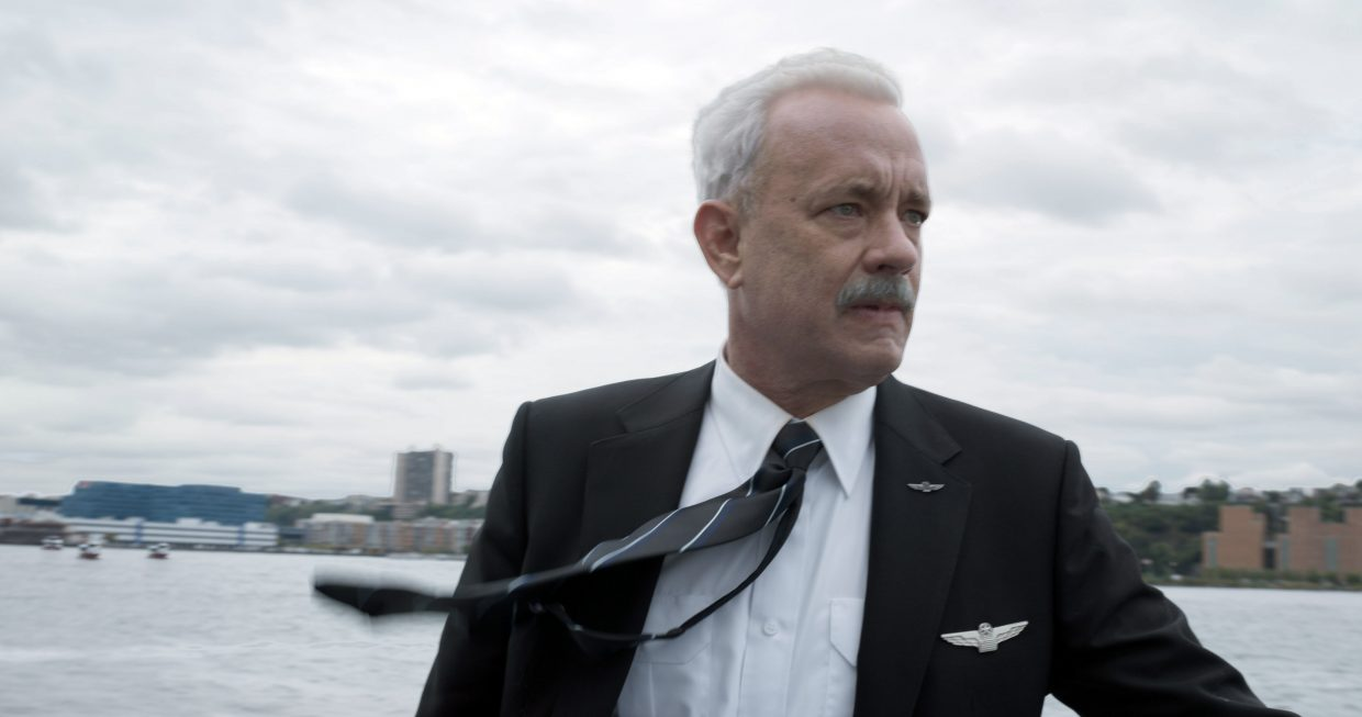"Pilot Chelsey Sullenberger (Tom Hanks) surveys the scene following an unusual landing in ""Sully."" The movie is about the events of a 2009 flight following an emergency landing on the Hudson River that beat all odds and resulted in no casualties."