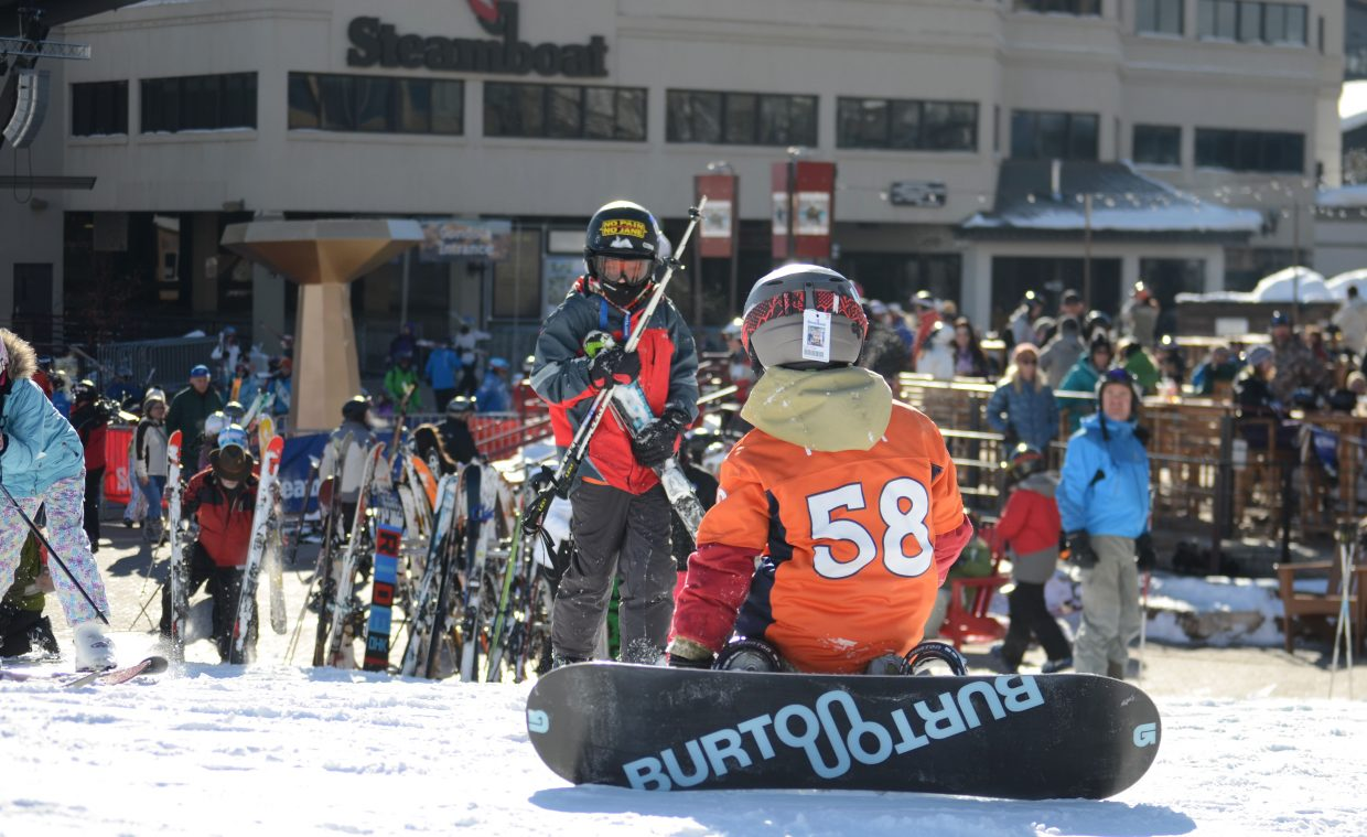 Soda Creek Elementary School student Parker Moline, 8, straps in for one last run at the ski area about an hour before kickoff of Super Bowl XLVIII wearing his Von Miller jersey.
