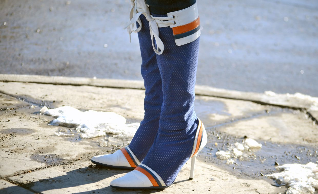 Elicia Lindahl, 31, of Steamboat Springs, flaunted some of the most unique pair of Denver Broncos boots along Lincoln Avenue prior to kickoff of Super Bowl XLVIII on Sunday.