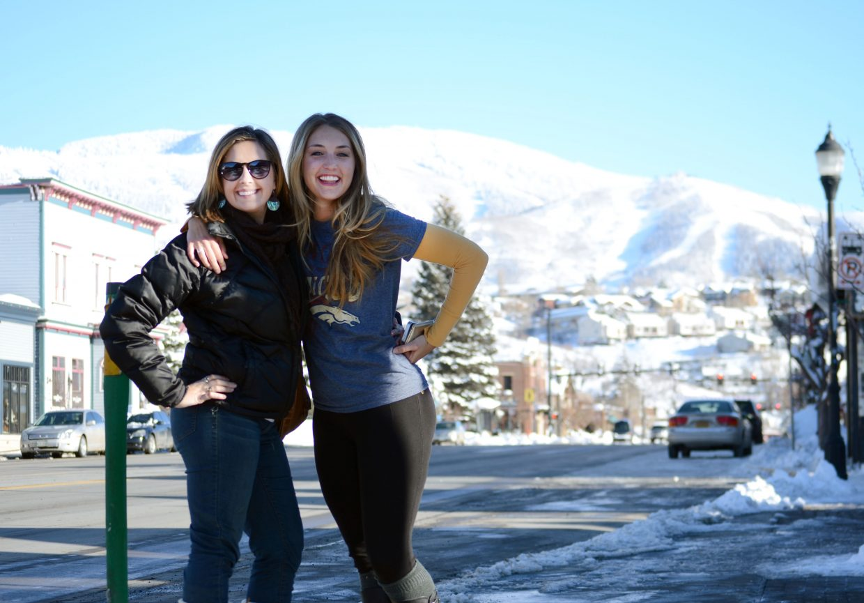 Leah Moore, left, and Heather Larson gear up across the street from Old Town Pub in downtown Steamboat Springs prior to kickoff of Super Bowl XLVIII on Sunday.