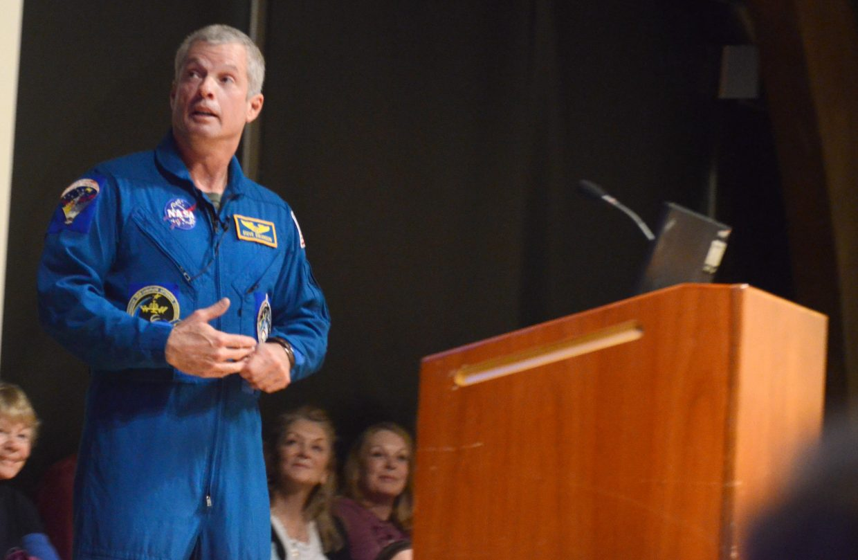 Steamboat Springs astronaut Steve Swanson speaks to a packed house Sunday evening at the Bud Werner Memorial Library. Swanson, who spent 169 days in space on Expedition 40, presented some of his memorable projects while on duty and fielded questions from the audience.