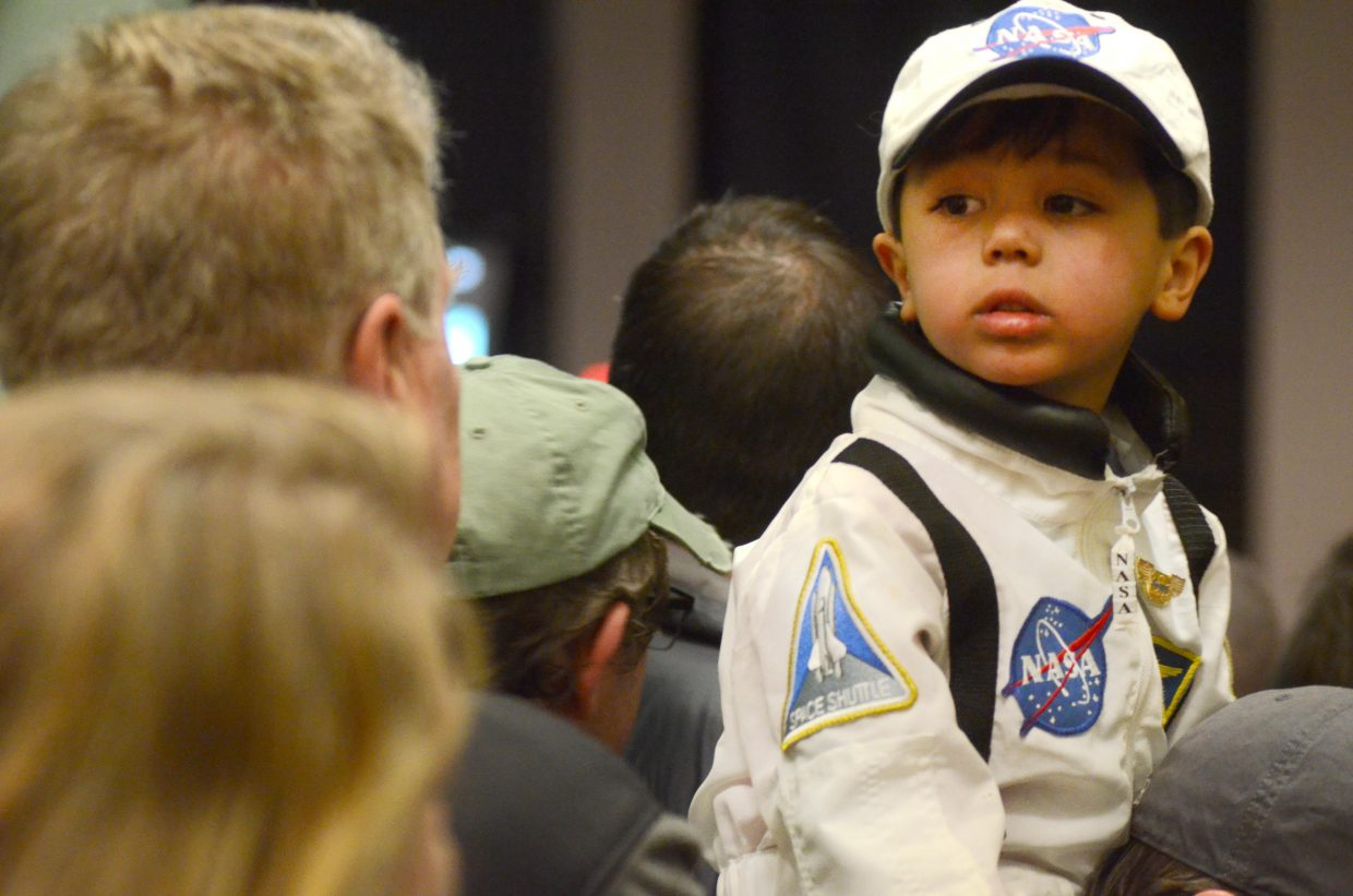 Keller Franko, 4, sits on his dad's shoulders in his very own NASA space gear during Steamboat Springs astronaut Steve Swanson's presentation Sunday evening at the Bud Werner Memorial Library.