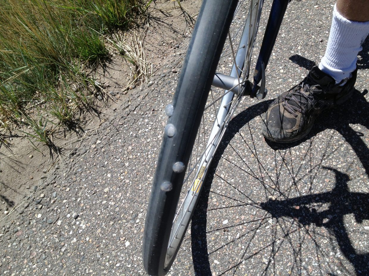 Steamboat's Linnea Dixson hit popped a bike tire Sunday along Colorado Highway 131. Dixson — who didn't compete in Sunday's Steamboat Triathlon — ran into a man on the same stretch of road who also blew a tire after running over several thumbtacks.