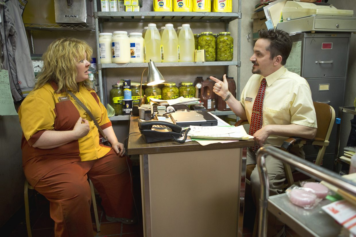 """Tammy (Melissa McCarthy) reacts to the news from her boss (Ben Falcone) that she's just been fired from her fast food job in """"Tammy."""" The movie is about a woman who, after experiencing the worst day of her life, decides to hit the road with her grandmother."""