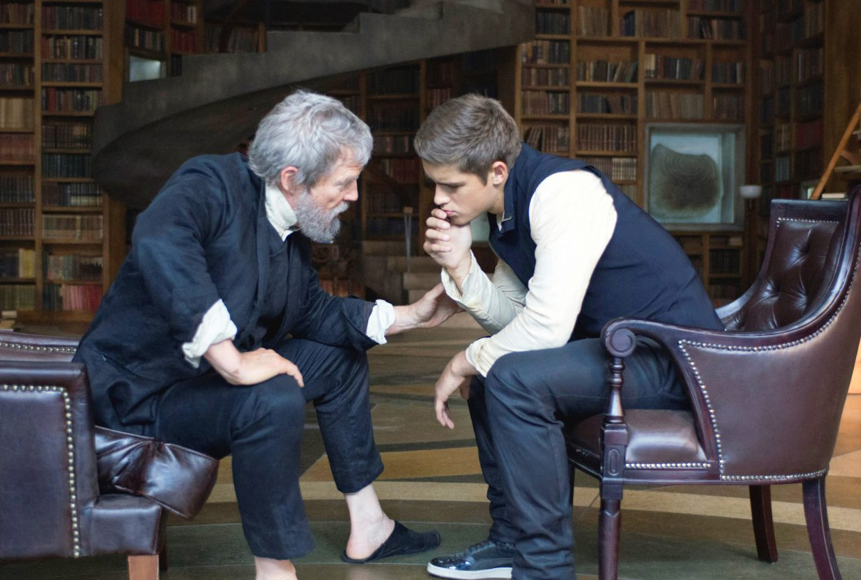 """Jonas (Brenton Thwaites) prepares to receive a memory from the title character (Jeff Bridges) in """"The Giver."""" The movie is about a society in which all pain and differences have been removed from the populace, at a price."""