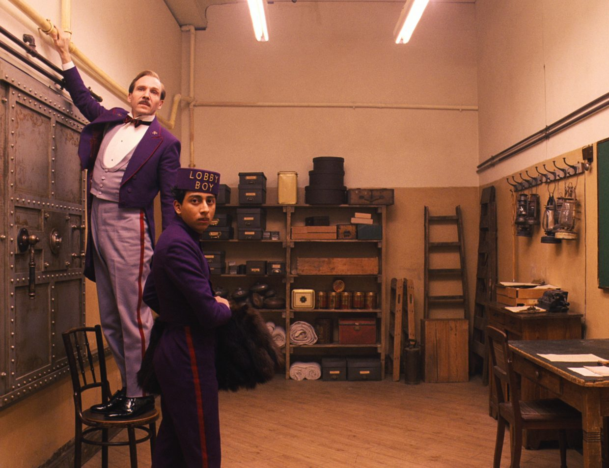 """Concierge Monsieur Gustave (Ralph Fiennes) and his assistant, Zero (Tony Revolori), scramble to keep stolen materials hidden in """"The Grand Budapest Hotel."""" The movie is about the adventures of the employees of a mountain resort in a fictitious European country in the 1930s."""