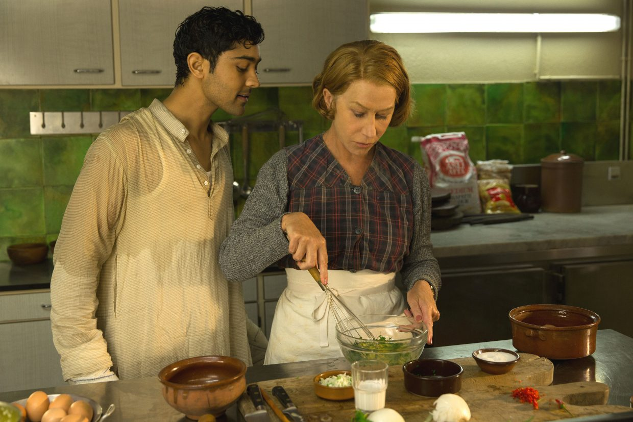 """Indian cook Hassan (Manish Dayal) and French restaurant owner Madame Mallory (Helen Mirren) collaborate on a dish in """"The Hundred-Foot Journey."""" The movie is about an Indian family that opens a restaurant in France directly across the street from a business with well-regarded cuisine."""