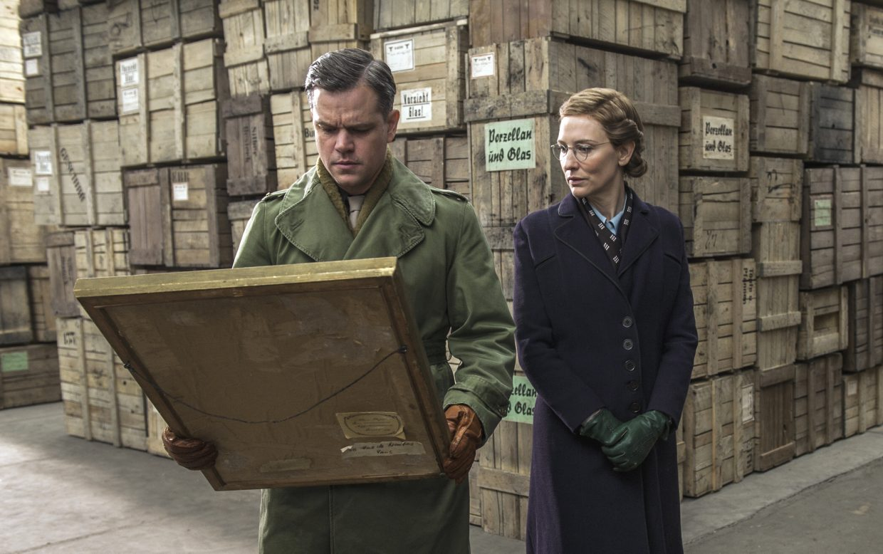 "Lt. James Granger (Matt Damon) and Claire Simone (Cate Blanchett) examine a painting in ""The Monuments Men."" The movie is about a group of American art experts who are tasked with recovering European artworks during World War II."